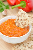 Roasted pepper dip with almonds, garlic, and whole grain bread Stock Photography
