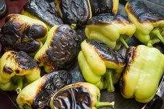 Roasted Peppers. Roasted and charred peppers on grill royalty free stock images
