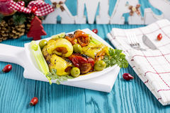 Roasted Peppers with Cheese, Olives, Onion, Parsley on Turquoise Table Royalty Free Stock Photo