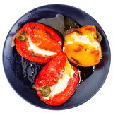Peppers baked with sheep cheese Stock Images