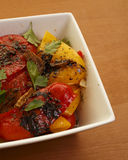 Roasted Peppers. Roasted red and yellow peppers with olive oil and garlic Royalty Free Stock Photo