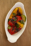 Roasted Peppers. Roasted yellow and red bell peppers with olive oil and lime juice Royalty Free Stock Images