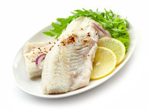 Roasted perch fish fillets on white plate. Roasted perch fish fillets on a plate isolated on white background royalty free stock photography