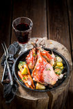 Roasted pheasant with bacon and vegetables and spices Stock Photos