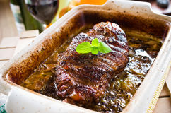 Roasted piece of lamb meat gravy Stock Photos