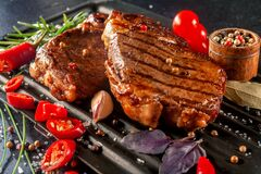 Free Roasted Pieces Of Meat With Vegetables And Spices Stock Photo - 225105120