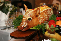 Roasted a pig. On the celebratory wedding decorated table Stock Photo