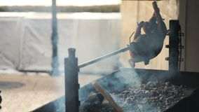 Roasted pig on the spit.  stock video footage