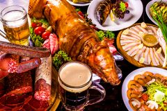 Roasted piglet, grilled fish, cold-boiled pork, beer and appetizers. Food table. Roasted piglet, grilled fish, cold-boiled pork, beer and appetizers Stock Photography