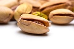 Roasted pistachio nut. Pistacia vera seed in shell with more nu Royalty Free Stock Image
