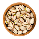 Roasted pistachio seeds with shell in bowl over white Stock Photography