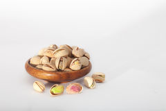 Roasted pistachio seeds in wooden bowl Royalty Free Stock Photography