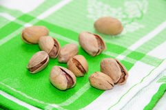 Roasted pistachios on a green tablecloth Stock Image