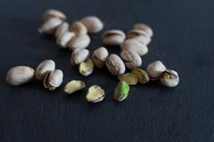 Roasted pistachios on slate Royalty Free Stock Photo