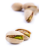 Roasted pistachios on a white background Stock Photo