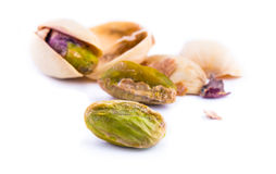 Roasted pistachios on a white background Stock Photography