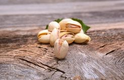 Roasted pistachios on wooden background Royalty Free Stock Photo
