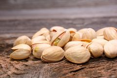 Roasted pistachios on wooden background Royalty Free Stock Image