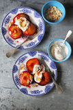Roasted plums with yogurt and toasted almond flakes Royalty Free Stock Photo