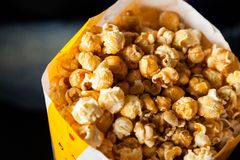 Roasted Popcorns In Paperbag At Cinema Theater Stock Photography