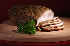 Roasted pork. On wooden cutting board Royalty Free Stock Photos