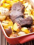 Roasted pork with baked potatos Stock Photos