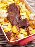 Roasted pork with baked potatos Royalty Free Stock Photo