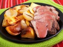 Roasted pork with baked potatos Stock Photography