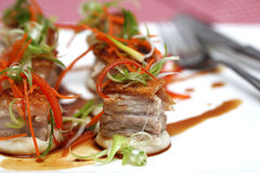 Roasted pork belly cubes on mashed potato with caramel Royalty Free Stock Photo