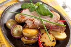 Roasted pork chop and potatoes Royalty Free Stock Images
