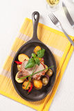 Roasted pork chop and potatoes Royalty Free Stock Image