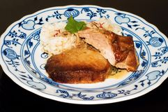 Roasted pork chop with saffron rice Royalty Free Stock Images