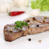 Roasted pork chop steak meat on a wooden table Stock Photo