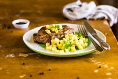 Roasted pork chops with pineapple salsa on a plate for lunch or dinner Royalty Free Stock Photography