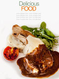 Roasted Pork Chops with Vegetables and Basil. Royalty Free Stock Photos