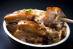 Roasted pork with colorful of sauce and spices in big black bowl Stock Photo