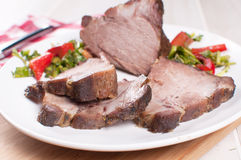 Roasted pork cut with vegetable salad Stock Image