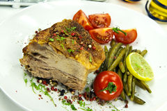 Roasted pork cutlet with  tomato salad Royalty Free Stock Photos