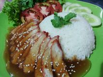 Roasted pork. Roasted duck, roasted pork crispy siu yuk and Charsiu Chinese style, served with steamed rice on dining table. Singapore cuisine.n Stock Image
