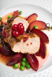 Roasted pork fillet with glazed apples Royalty Free Stock Images