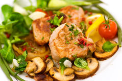 Roasted pork fillet - tenderloin with vegetables Royalty Free Stock Images