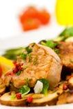 Roasted pork fillet - tenderloin with vegetables stock images