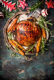 Roasted pork ham with vegetables , cutlery  and Christmas decoration Royalty Free Stock Image