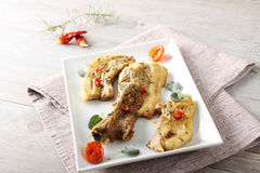 Roasted pork with herbs. On complex background Royalty Free Stock Image
