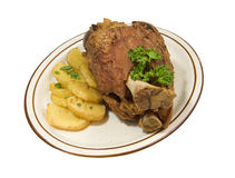 Roasted pork hog with potatoes Royalty Free Stock Photo