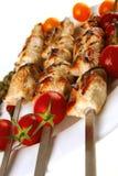 Roasted pork kebab on white Royalty Free Stock Photos