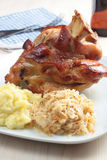 Roasted pork knuckle. With mashed potato and braised sauerkraut Stock Photo