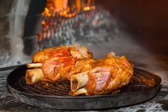 Roasted pork knuckle. Baked in a brick oven Stock Images