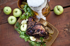 Roasted pork knuckle with beer and mustard Royalty Free Stock Photo