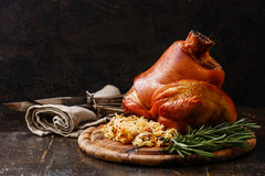 Roasted pork knuckle eisbein. With braised boiled cabbage and rosemary on wooden cutting board Stock Photos